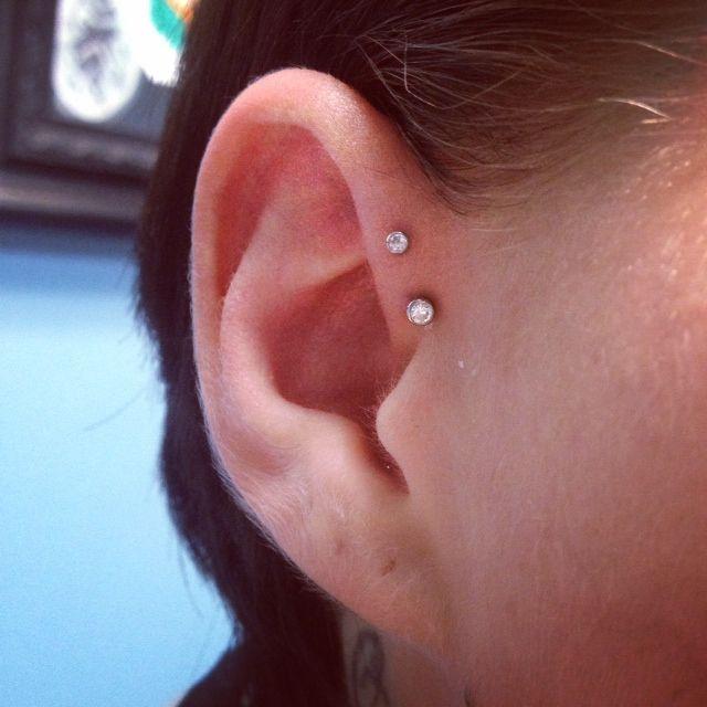 Best 25 double forward helix piercing ideas on pinterest for Tattoo shops in mobile al