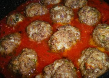 I found this recipe on the Food Network website on Throwdown with Bobby Flay. It is from Maroni Cuisine in Northport, New York. I saw the episode and was inspired to make the meatballs. Boy am I glad I did. They are so good! Truly the best meatballs I have ever eaten. http://www.foodnetwork.com/recipes/throwdown-with-bobby-flay/grandma-maronis-meatballs-100-year-old-recipe-recipe/index.html The original recipe uses ounces-I have somewhat converted it into ...