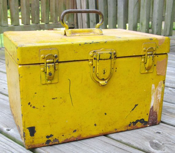 yellow vintage tool box (?) for storing all kinds of stuff. great for industrial style