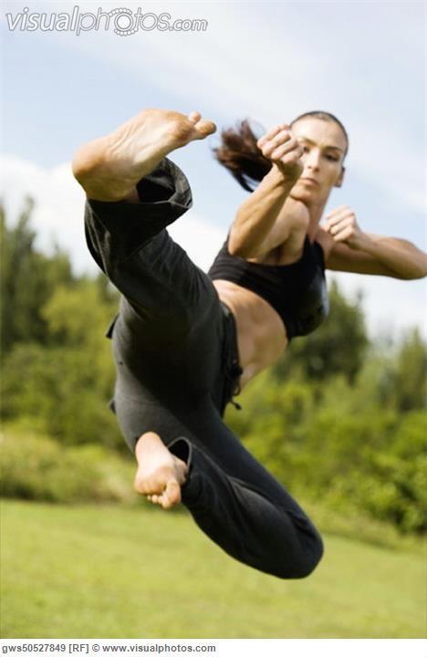 mid_adult_woman_practicing_martial_arts_gws50527849.jpg 468×720 pixels