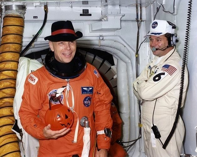 Dr. Story Musgrave clowns around during STS-33's countdown test in 1989. Photo Credit: Retro Space Images.