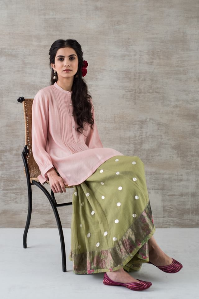 SUSTAINING TRADITIONS OF CRAFT & STYLE 'Khadi,' muslin & 'chanderi' separates in rose, lilac & leaf with 'odhnis' (scarves) coordinated in 'leheriya' (tie-dye) & 'varak' (silver leafed) graphic patterns. 'Varak' is a delicate decorative leaf hammered by hand from tiny bits of silver. These delicate leaves are carefully applied on handwoven gossamer fabrics. These textiles are treasures & need to be handled with care. #SustainableLuxury Available across Good Earth shops in Mumbai & Delhi.