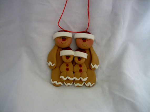 Gingerbread family of 2 adults with 2 children or can be a unique gift for grandparents with 2 grandchildren. Ornament measures 3 inches by 3