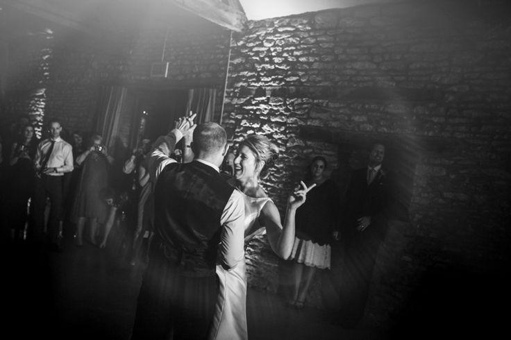 The newlyweds enjoying their first dance. Photo by Benjamin Stuart Photography #weddingphotography #blackandwhite #brideandgroom #firstdance #weddingparty #couplephoto