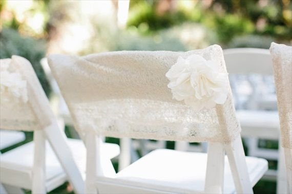 I love this look for an alternative to typical chair covers.  7 Stylish Wedding Chair Covers (photo: marianne wilson)