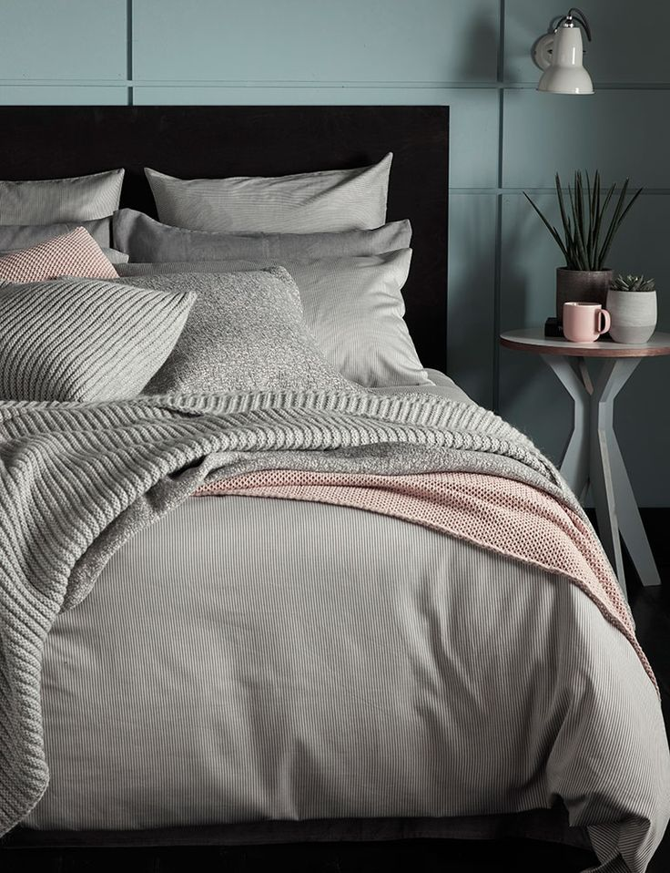 Tiny stripe graphite grey bedding set. We love mixing dusky pinks and grey together. A new look for our Tiny Stripe Graphite Grey bed linen. Layered up with pink and grey throws and pastel accessories.