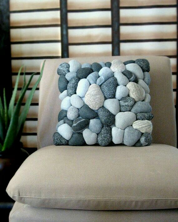 River rock pillow. I've seen these go for $300 on here. However you can make one yourself. DIY time. Gather / buy (hit up your thrift stores) about 50 socks with different shades of gray (in different sizes) Even the white socks that have gray tip toes/heels. Fill them up with pillow stuffing (fluff) about size of fist, flatten and tie, clip off excess. Do this with all then sew back to back (or simpler way onto gray pillow).  G;)