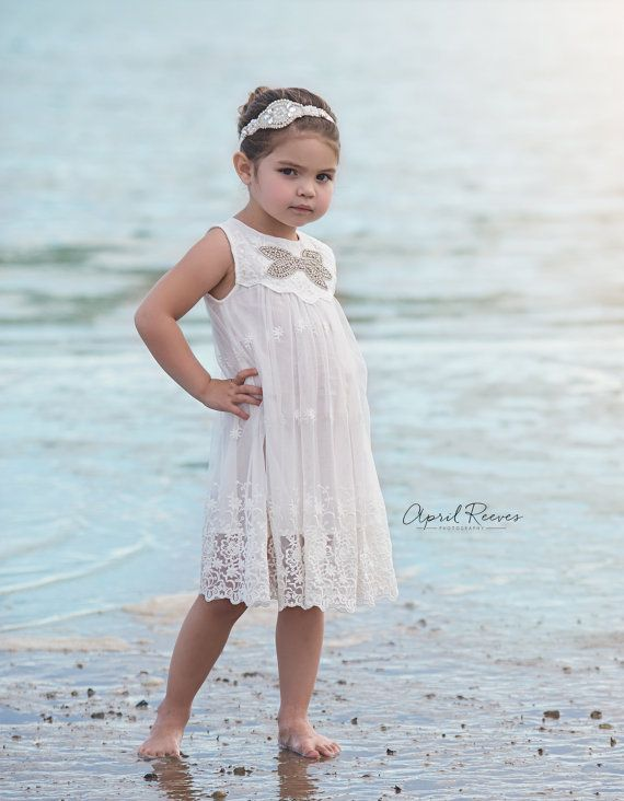 How adorable for a beach wedding!  The bling rhinestone bow just sparkles in the sun.  Flower Girl Dress White Flower Girl Dress by FlowerGirlsCouture