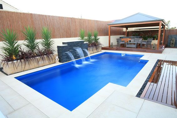 This rectangular pool's color is leaning towards a cobalt blue...
