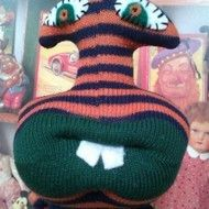 Bertie is a sock monster alien measuring 34cms from head to toe and is made from a new pair of orange and dark blue striped boys socks with dark green mouth, feet and bottom. He has a banana shaped eye stalk with hand sewn green, orange and white felt ...