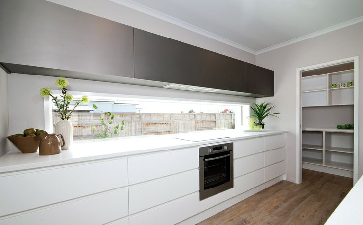 Kitchen detail showing Melteca Cabinetry above  the stretched window