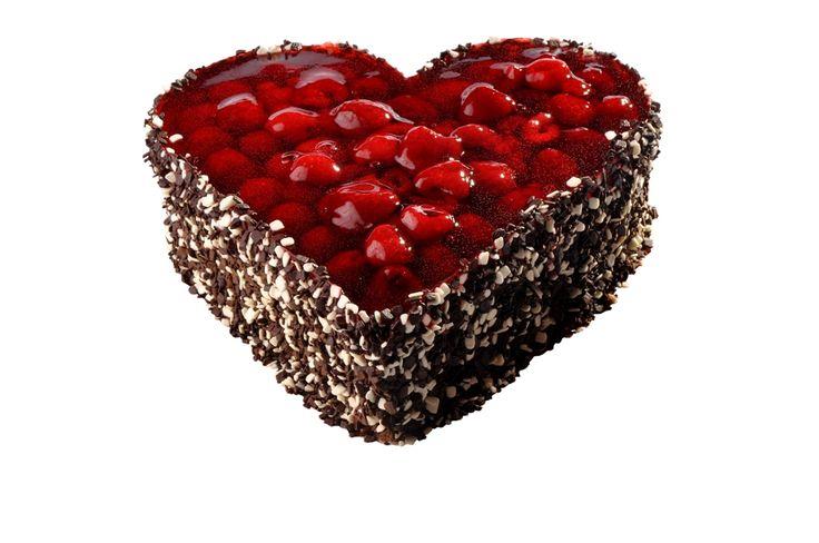 Dortové srdce Čokomalinové Dort ve tvaru srdce s nízkým lehkým čokoládovým piškotem nese lahodný čokoládový krém, svrchní kabát je tvořen šťavnatými malinami v želé, zdobený dvojbarevnou čokorýží.