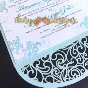 Simply Snow laser-cut details. I'm in love with this soft blue laser cut with delicate swirls