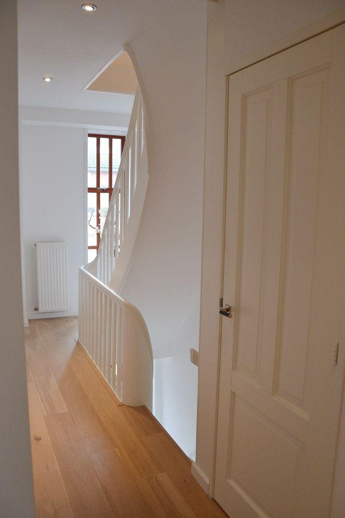 Stylish hallway in Amsterdam apartment. Nice stairway.