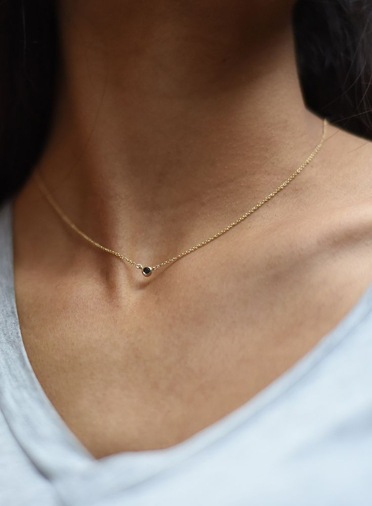 Mejuri black diamond necklace in 14k solid gold and a black diamond
