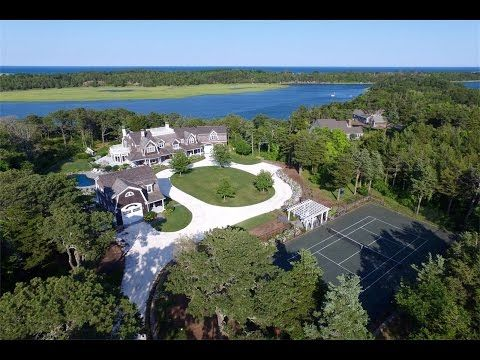 Welcome to the premier edition of New England Real Estate Properties Showcase. Today's spotlight features a large and spacious Cape Cod waterfront compound, a sophisticated waterfront condo in Newport, Rhode Island, and an Italian-inspired home in Brookline, MA.