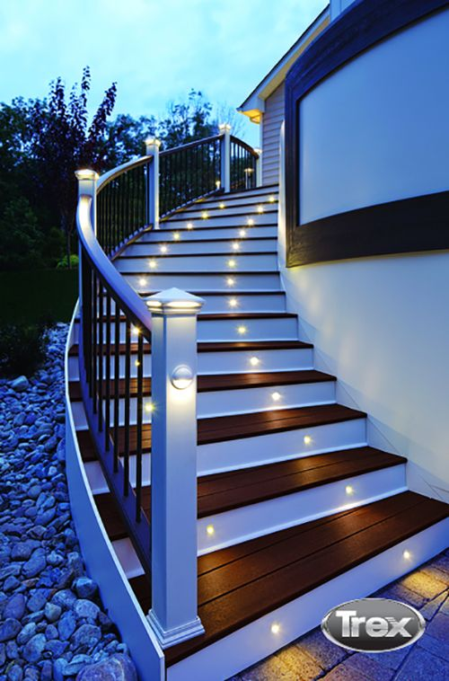 Trex Outdoor Lighting keeps your outdoor living space glowing all year long. #deck #backyard #outdoorliving #patio #porch #decklighting #compositedecking