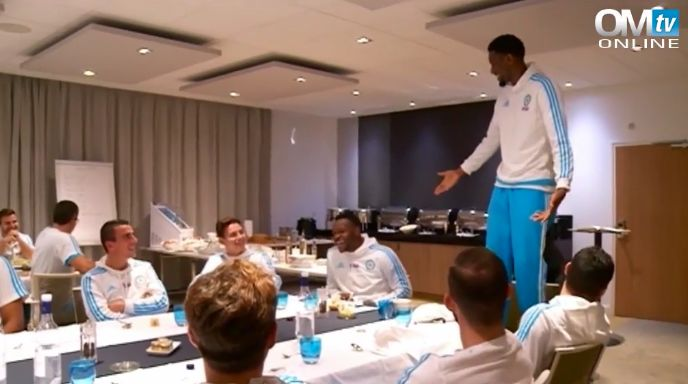 Injury-prone Abou Diaby tempts fate by standing on chair for Marseille initiation (Video)