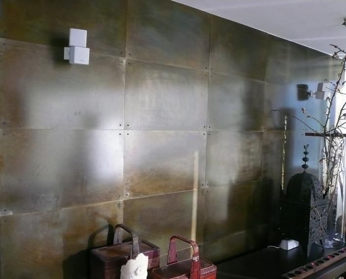 steel wall panels with patina finish and steel rivets for fireplace in great room - Metal Wall Designs