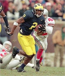 Charles Woodson/Michigan football. He was a two-time All-American and remains the only defensive player to ever win the Heisman Trophy.