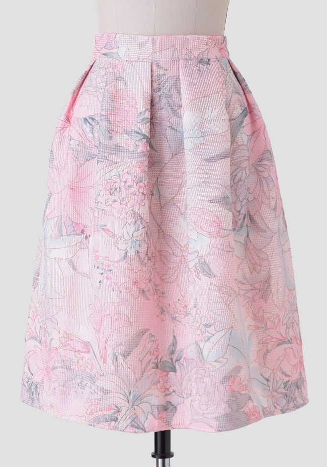 Create a variety of romantic-inspired ensembles with this light pink midi skirt featuring a textured grid design and a watercolor floral print in pale hues of lavender, light blue, sage, and crea...