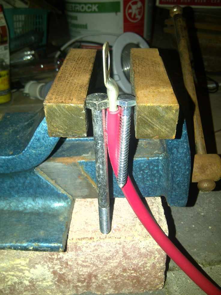 Cable Crimping Tool by marcoscova -- Homemade cable crimping tool constructed from blocks of wood, a pair of bolts, and a vise. http://www.homemadetools.net/homemade-cable-crimping-tool