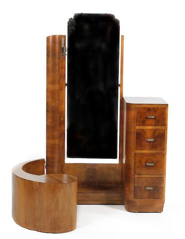 An unusual Art Deco figured walnut and walnut dressing table, 1932 Bearing paper manufacturer's label to underside reading 'Maker No.: 33, Date: 15.5.32 Sold for £360 (US$ 556) inc. premium