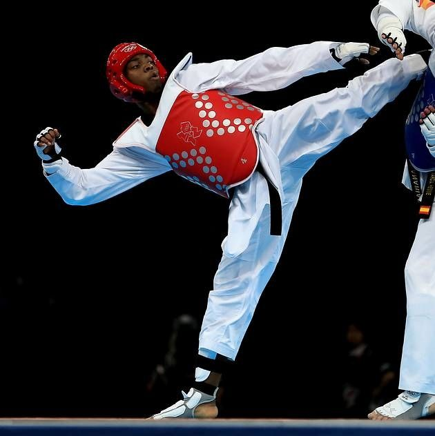 Great Britain's Lutalo Muhammad won a bronze medal in the -80kg taekwondo competition -Day 14