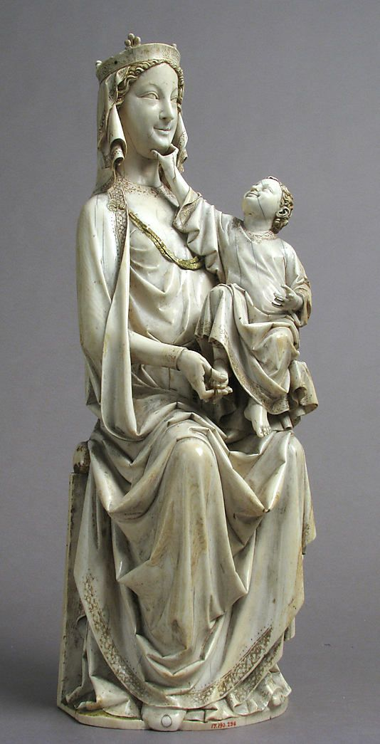 Enthroned Virgin and Child Date: ca. 1275–1300  Culture: French  Medium: Ivory with original paint  Dimensions: Overall: 16 x 5 1/8 x 4 3/8 in. (40.6 x 13 x 11.1 cm) 10.5lb. (4762.8g) Accession Number: 17.190.296 The Metropolitan Museum of Art