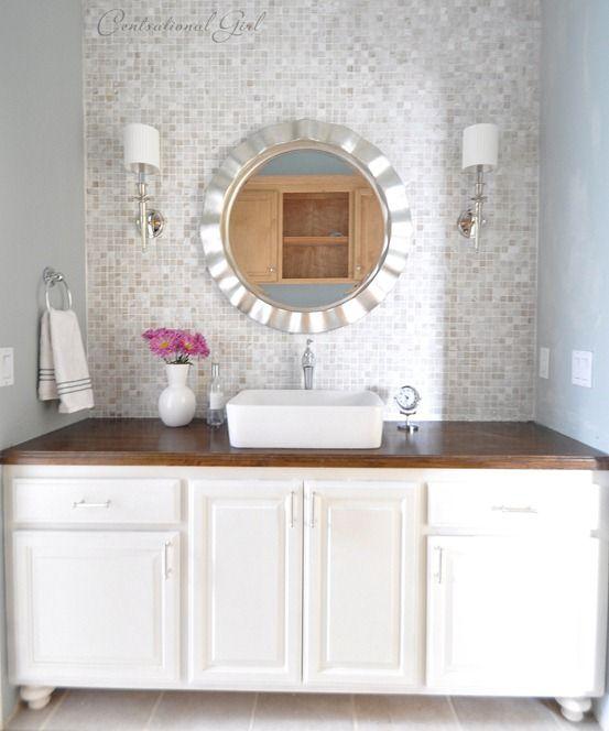 Tiled wall behind bathroom vanity. Love wood counter and storage in unit.   Bathrooms ...