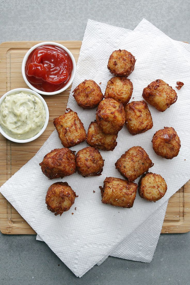 Hot Dog Tots  5-6 hot dogs, each cut into 4-5 pieces  900 g potatoes, peeled  1 tablespoon salt  Water  1 cup parmesan cheese  2 tablespoons flour  1 teaspoon oregano  Oil for frying