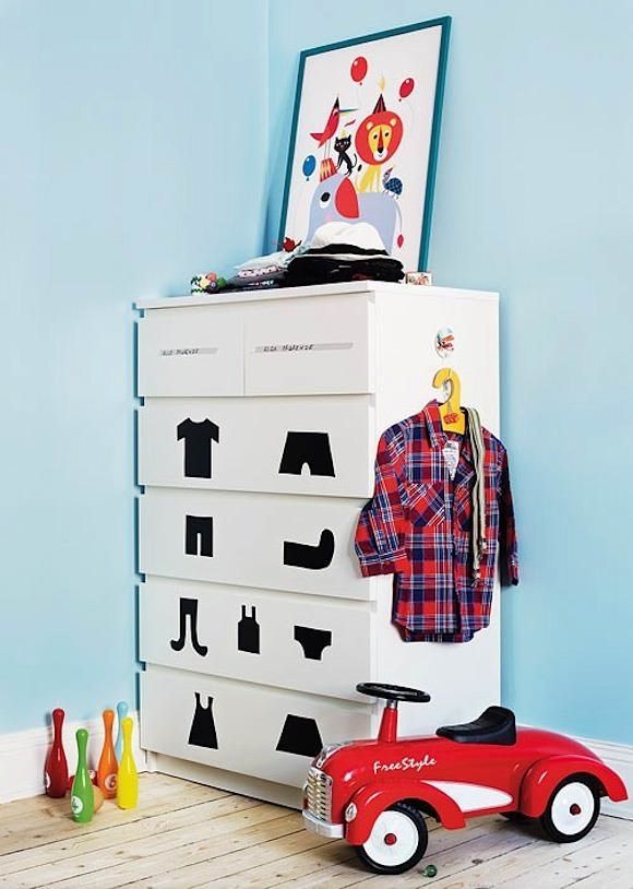Cut-out clothing shapes on the front of the dresser help a toddler find and put away clothes independently. Brilliant!