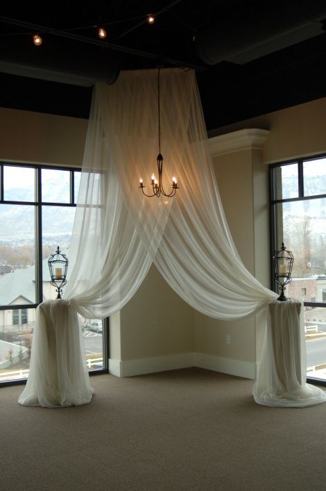 Altar decor drape  Ash & Min- this is what I was talking about. White lights underneath. Just don't want pillars, something different.