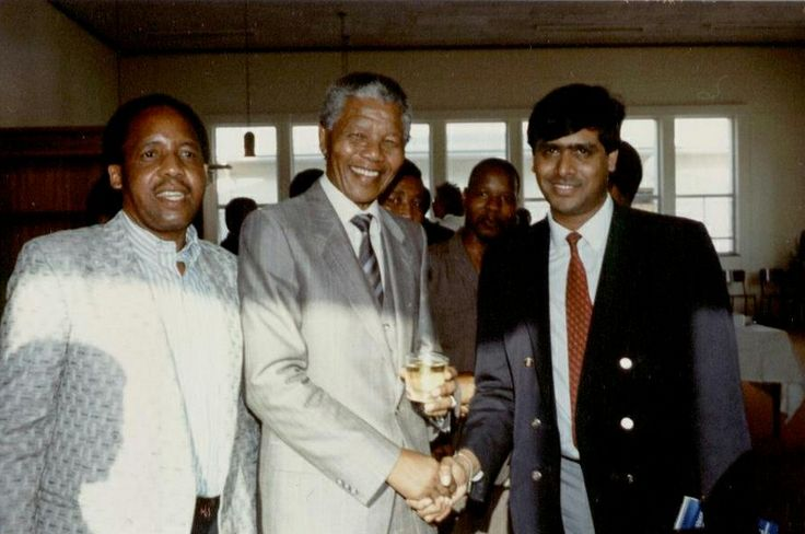 Chris Hani, left, Nelson Mandela, centre, and Yogin Devan at a rally in Transkei. Submitted by Loges Devan