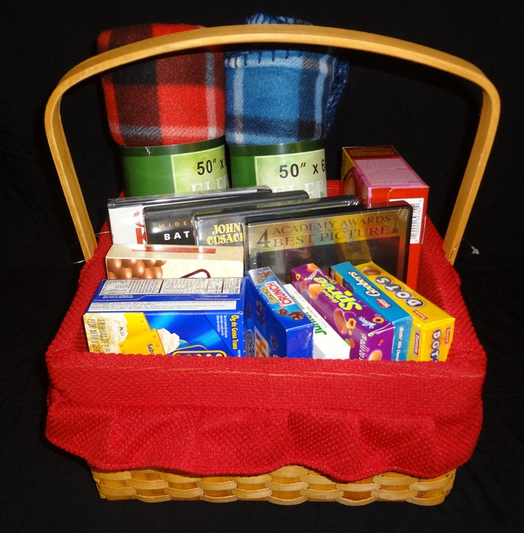 Movie Night!  Basket features 4 movies (A Beautiful Mind, Batman Begins, Serendipity, and Christmas with the Kranks), popcorn, hot chocolate, your favorite candy treats, and two snuggly blankets.