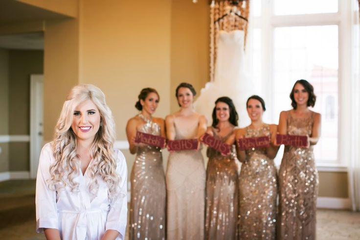 Must-have wedding photo idea with the bridesmaids all holding signs of how they met the bride (Limelight Photography)