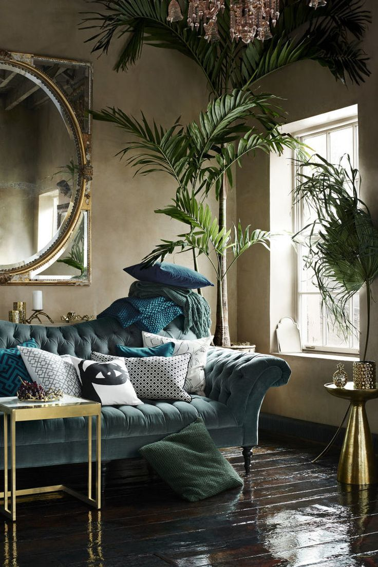 Glamorous living room with a blue velvet sofa and gold accessories.