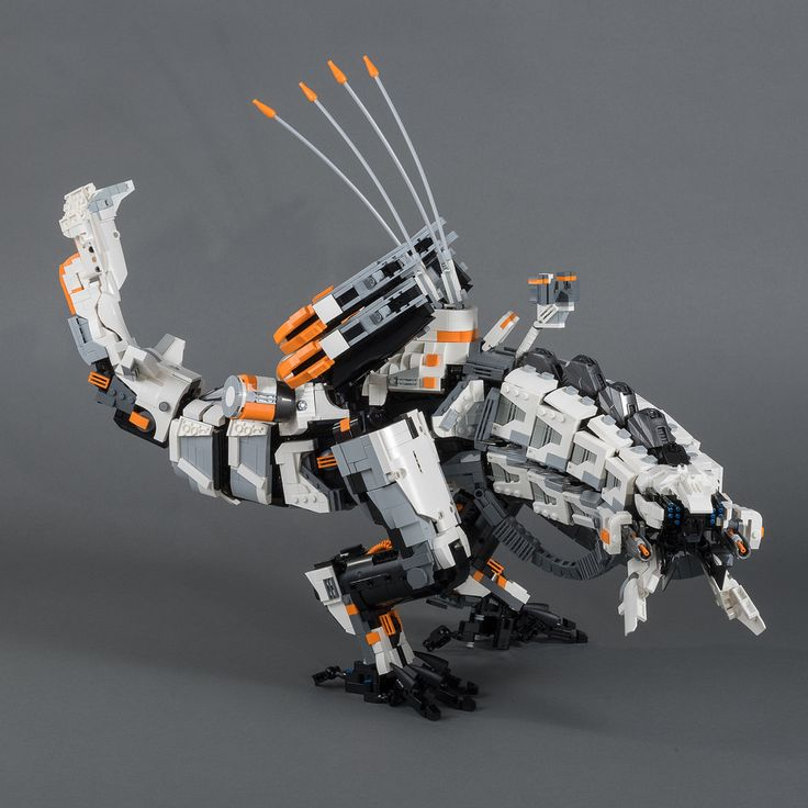 https://flic.kr/p/T7mdZh | Thunderjaw (2nd Edition) | Since my original Thunderjaw build, I spent dozens of hours with the game and decided that my MOC missed the mark in some places.  Now I had a lot more reference material to work from so I did some major overhauls. I reworked the entire neck section. Brought the side panels further up and replaced most of the light  grey with old grey pieces. This gives the machine a dirtier and more believable look. I also made some adjustments to the…