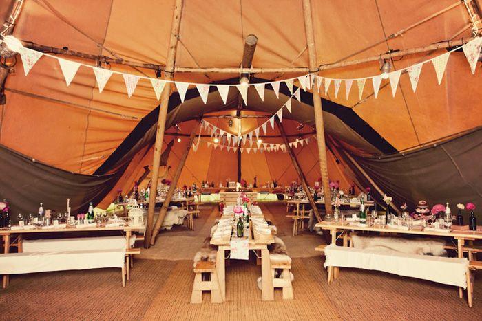 A teepee tent interior. Photo Source: Boho Weddings. #weddingtent #teepeetent