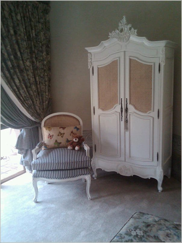 Lovely Armoire and chair with rattan details, in a guest bedroom