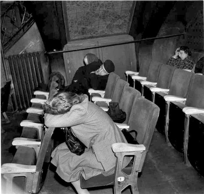 Robert Doisneau //   Sleeping in a theater. Paris  ca. 1944