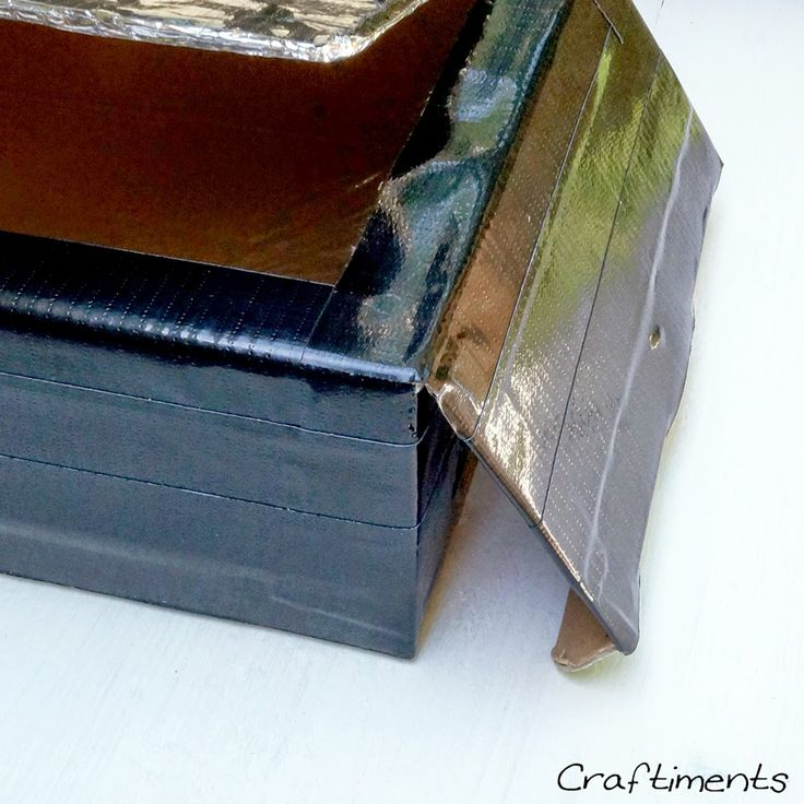 cover solar oven with black duct tape