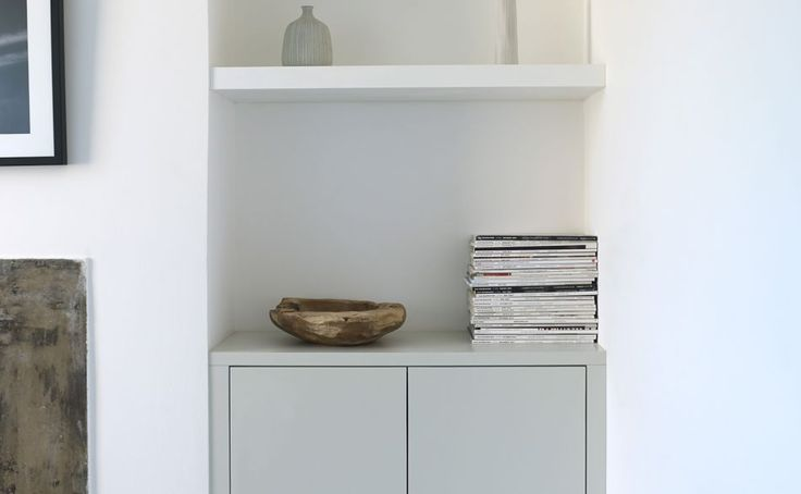 Shelves in the alcove created by a Victorian home's chimney breast.