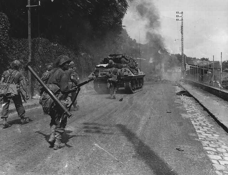 U.S. Bazooka Squad follows close behind an M10 Tank Destroyer.