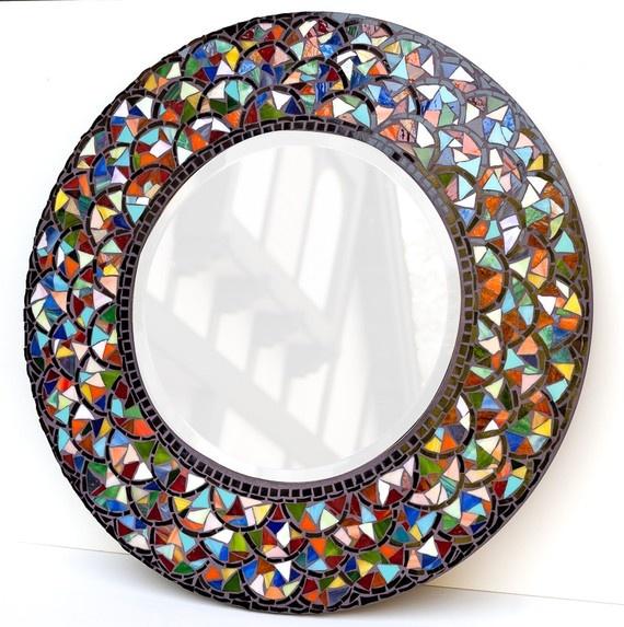 diy mosaic mirror above fireplace