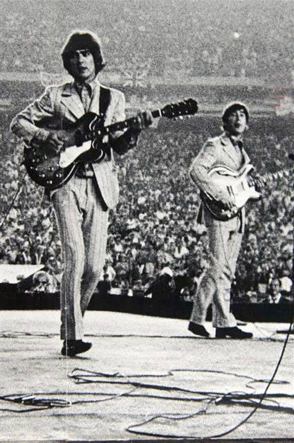 George Harrison and John Lennon, Shea Stadium, 1966.