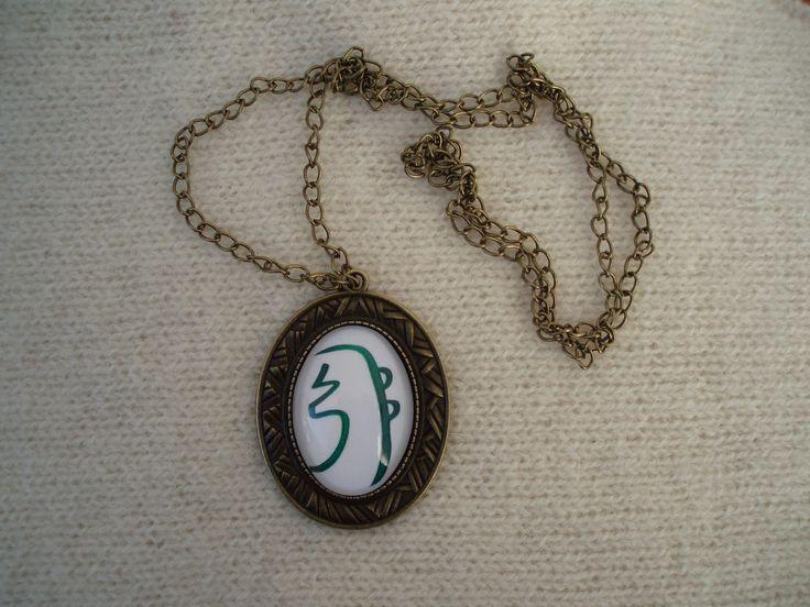 Colar co medalhão com o síbolo sagrado Sei-Heki