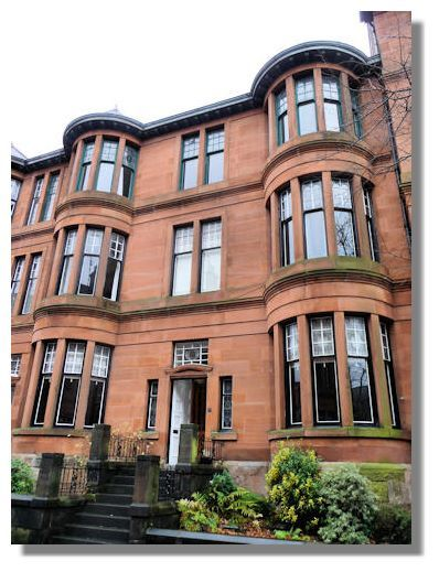 A traditional style of Glasgow tenements with the curved outward bay windows and standard 3 floor height.