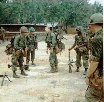 Vietnam - patrol getting ready to saddle up and move out - again, same as yesterday and same as tomorrow - only contact will break the boredom and that's a terrible price to pay to break the monotony