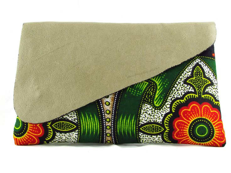 The Nala Bloom, A gorgeous small clutch created with vibrant African fabrics and leather. Hand stitched by Handmade by FUNDI and brought to you by Modern Tradition - Where tradition meets today!